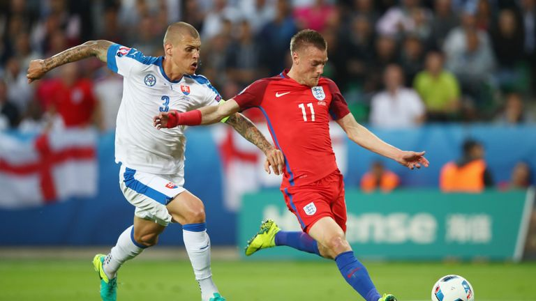 Jamie Vardy of England and Martin Skrtel of Slovakia compete for the ball