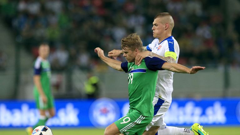 Slovakia's Martin Skrtel (right) and Northern Ireland's Jamie Ward battle for the ball during the International Friendly match at the Antona Malatinskeho S