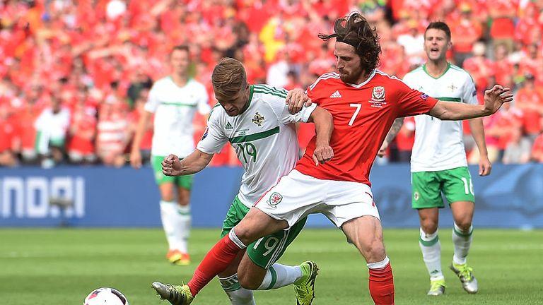 Wales' midfielder Joe Allen (R) vies for the ball with Northern Ireland's midfielder Jamie Ward during the Euro 2016 match