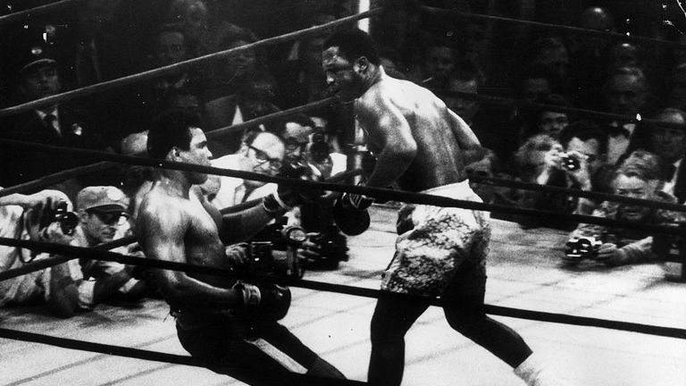 Joe Frazier fells Ali with a left hook in the 15th and final round
