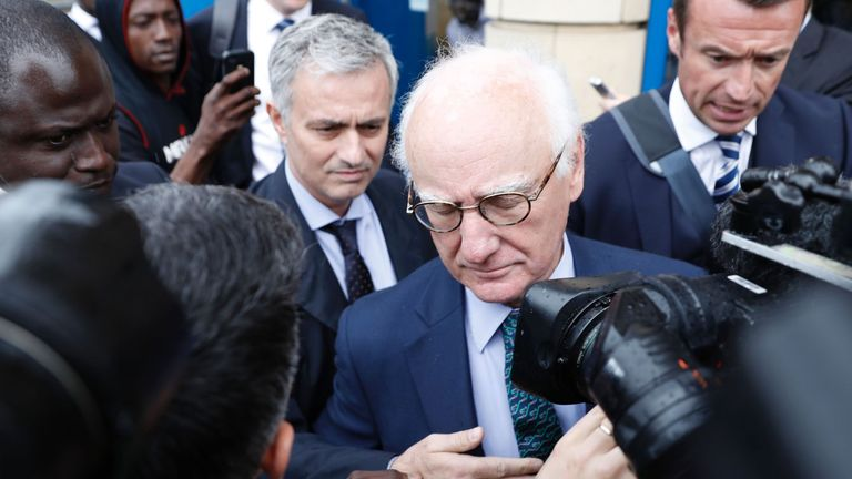 Former Chelsea and current Manchester United manager Jose Mourinho leaves with Bruce Buck