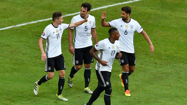 Germany midfielder Julian Draxler (left) celebrates with team-mates after scoring