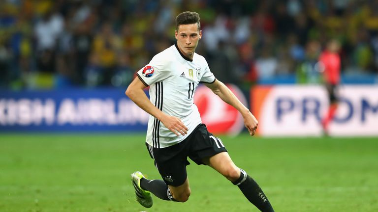 Julian Draxler of Germany runs with the ball against Ukraine