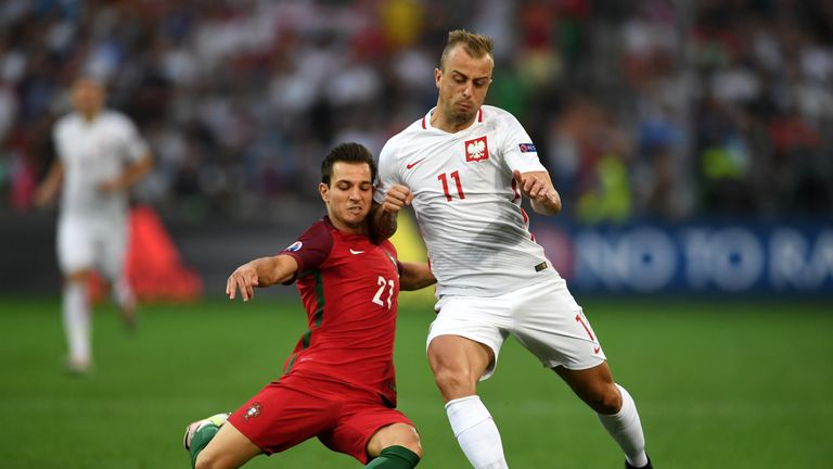 Kamil Grosicki is tackled by Cedric Soares