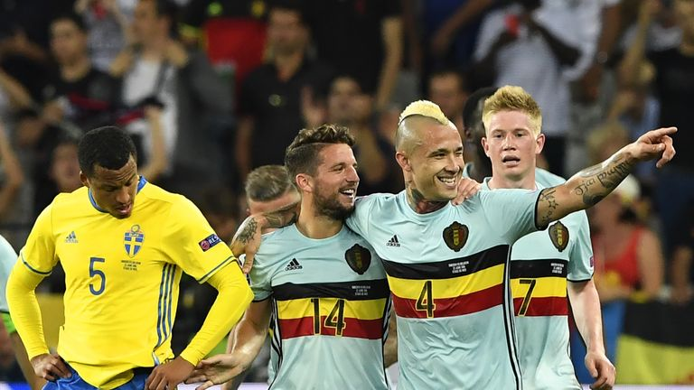 Belgium midfielder Radja Nainggolan celebrates a goal with forward Dries Mertens and Kevin De Bruyne