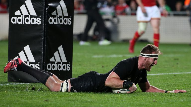 All Blacks captain Kieran Read slides over the line