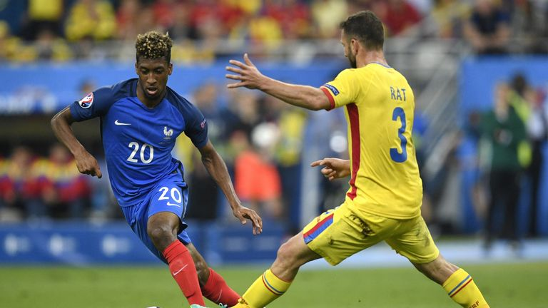 France's forward Kingsley Coman vies for the ball with Romania's defender Razvan Rat during the Euro 2016 group A football match between France and Romania