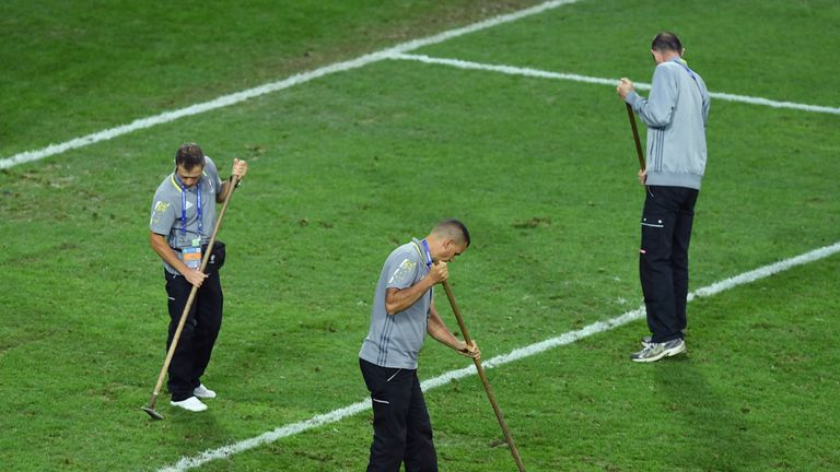 Ground staff tend to the Lille pitch during France's draw with Switzerland
