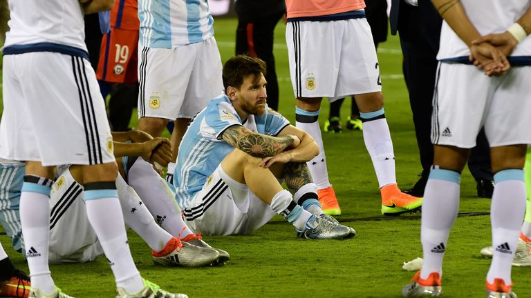 Argentina's Lionel Messi sits on the ground in dejection after being defeated by Chile in the penalty shoot-out of the Copa America Centenario final in Eas