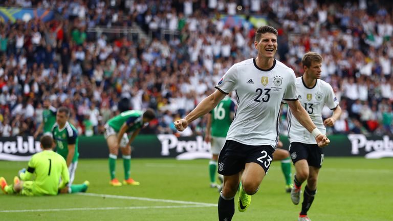 Mario Gomez of Germany celebrates scoring the winner