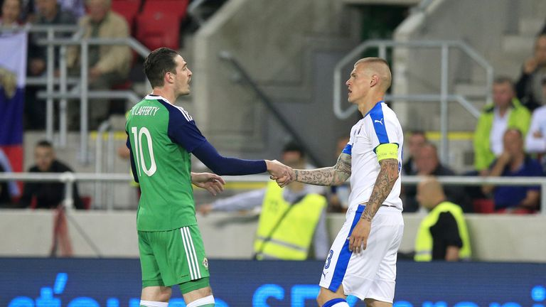 Slovakia's Martin Skrtel (right) and Northern Ireland's Kyle Lafferty shake hands