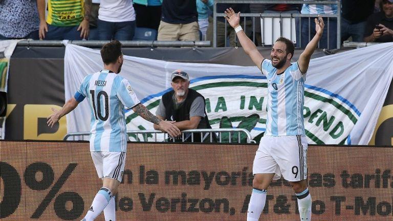 Gonzalo Higuain celebrates with Lionel Messi