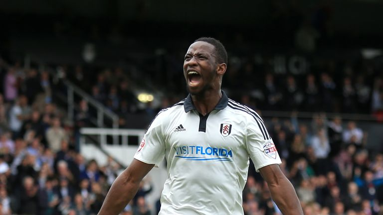 Moussa Dembele celebrates after scoring for Fulham last season