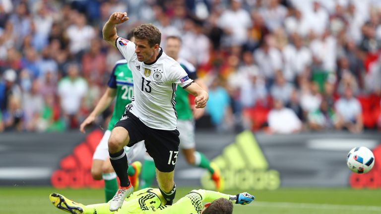Michael McGovern denies Thomas Muller in the early stages