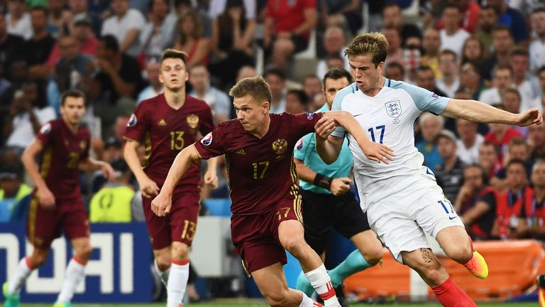 Russia's midfielder Oleg Shatov (C) is marked by England's midfielder Eric Dier (R) during the Euro 2016 group B football match between England and Russia