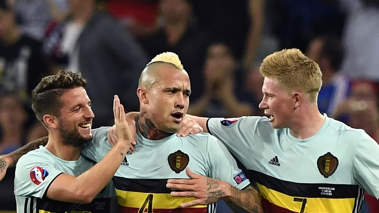 Radja Nainggolan (centre) says there have been talks over a move to Chelsea