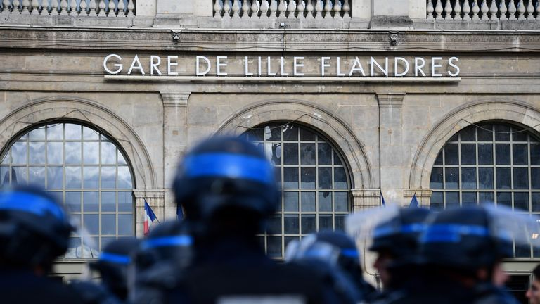 French police stand guard near the main train station in Lille, where Russia and England fans are