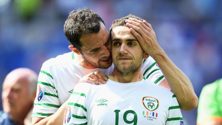 Robbie Brady (R) of Republic of Ireland is consoled by John O'Shea (L)