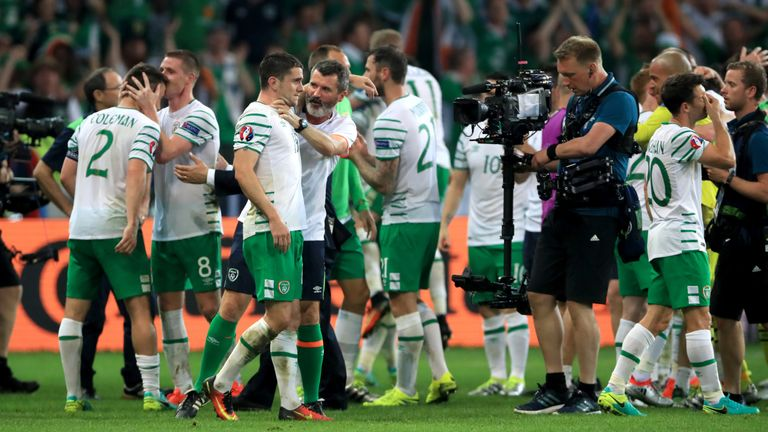 Republic of Ireland's Robbie Brady (left) is  manhandled by Roy Keane after his winner against Italy