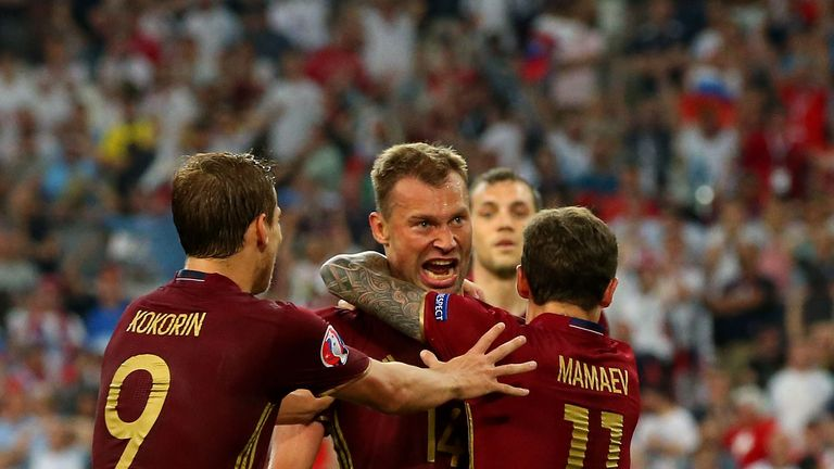 Vasili Berezutski celebrates his last minute equaliser for Russia