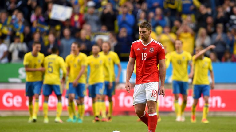 Wales' Sam Vokes appears dejected after Sweden's first goal