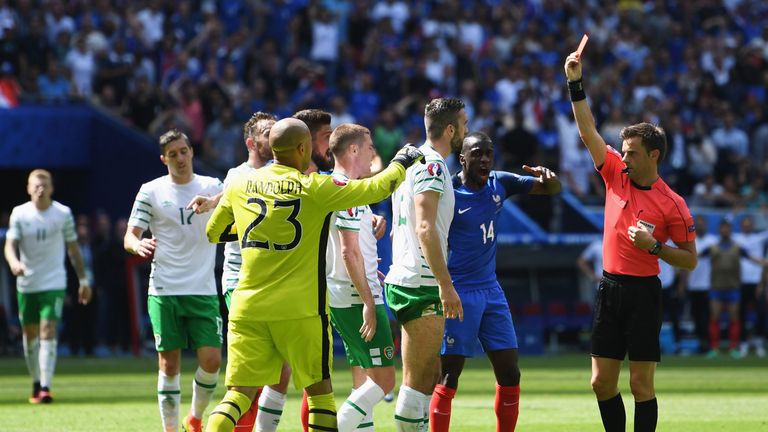 Republic of Ireland's Shane Duffy is shown a red card against France