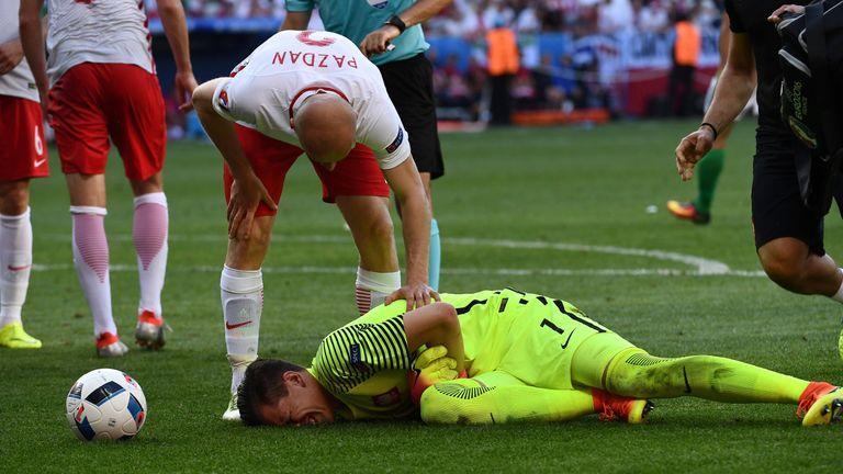 Wojciech Szczesny (down) suffered a thigh injury during Poland's 1-0 win over Northern Ireland