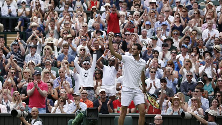 Ward celebrates fighting back in the second set against Djokovic