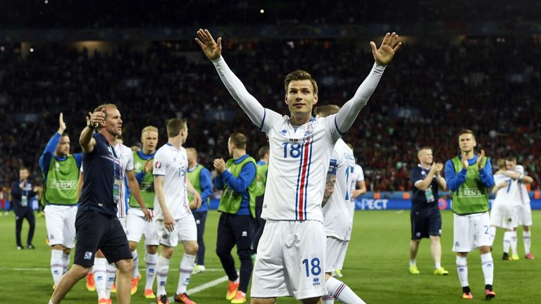 Iceland's midfielder Theodor Bjarnason (C) and his teammates celebrate after a 1-1 draw with Portugal