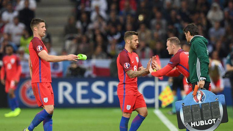 England's forward Wayne Rooney (R) comes on for England's midfielder Jack Wilshere (C)
