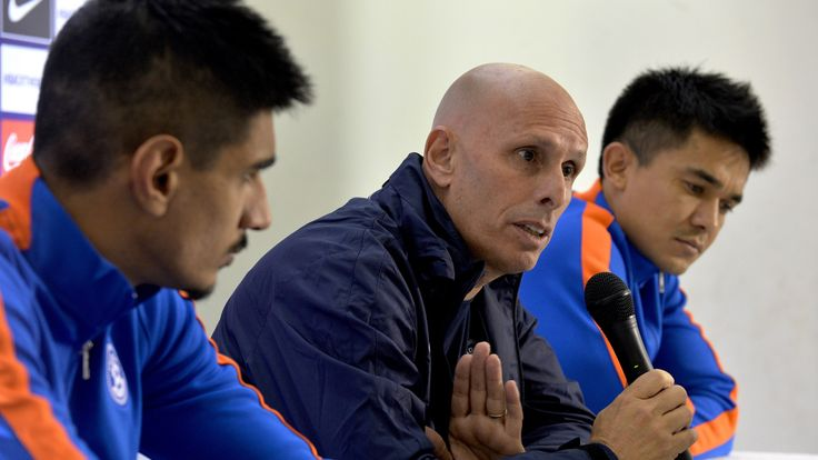 India coach Stephen Constantine addresses a press conference as footballers Sunil Chhetri and  Gurpreet Singh look on in November 2015