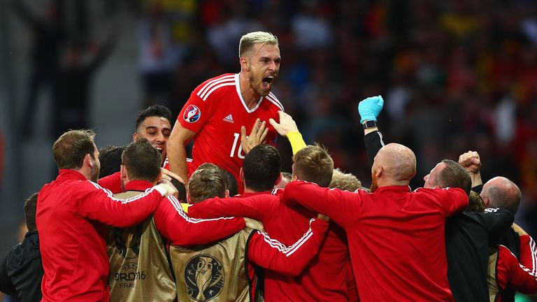 LILLE, FRANCE - JULY 01:  Aaron Ramsey (top) and Wales players celebrate their team's first goal by Ashley Williams (obscured) during the UEFA EURO 2016 qu