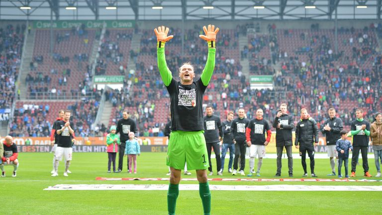 Manninger celebrates with Augsburg fans after the Bundesliga match against Hamburg in May