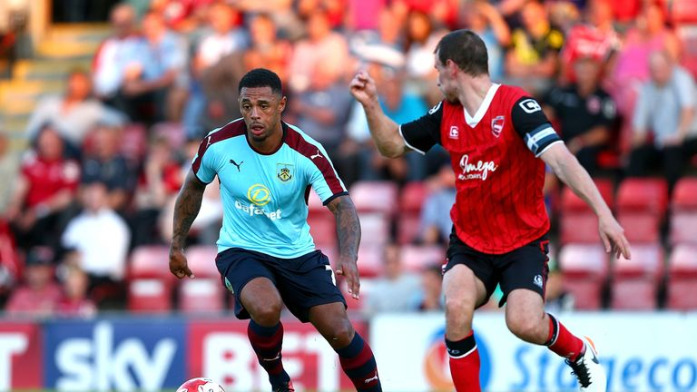 Andre Gray (L) shows off Burnley's away strip for the new season in a recent friendly against Morecambe
