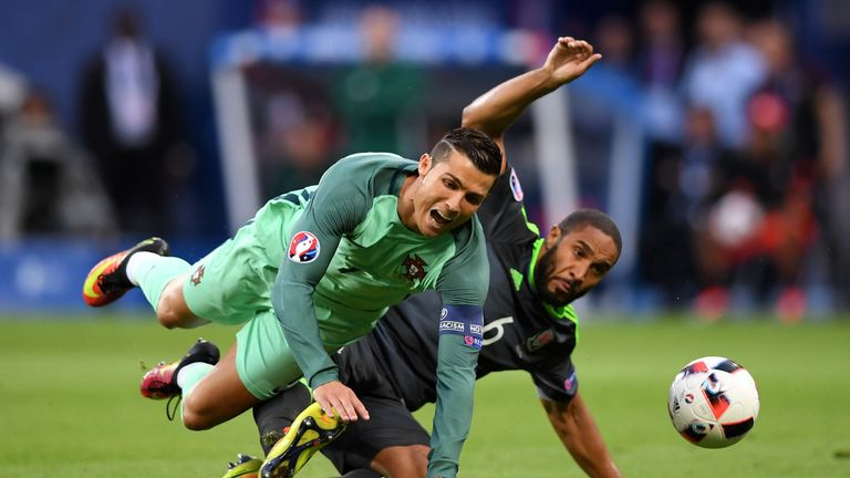 Ashley Williams of Wales tackles Cristiano Ronaldo of Portugal during the UEFA EURO 2016 semi final match in Lyon