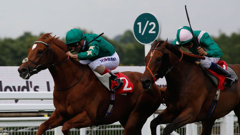 Ayrad ridden by Andrea Atzeni leads Spark Plug ridden by Sean Levey home to win The Ambant Gala Stakes Race run during Racing UK Ladies' Day at Sandown Rac