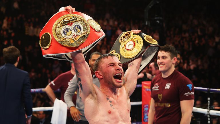 MANCHESTER, ENGLAND - FEBRUARY 27:  Carl Frampton celebrates a points victory over Scott Quigg after their World Super-Bantamweight title contest at Manche