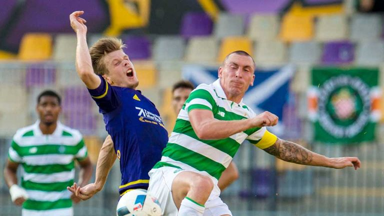 Celtic's Scott Brown (right) in typically combative mood in Maribor