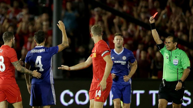 Cesc Fabregas of Chelsea receives a red card