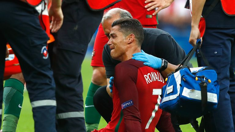 Cristiano Ronaldo is consoled after picking up an injury that forced him off in the first half of the Euro 2016 final