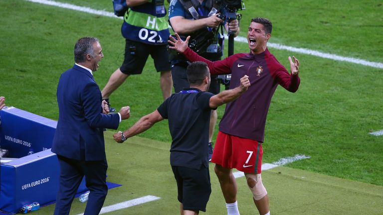 Ronaldo celebrates with his team from the touchline as Portugal win the tournament