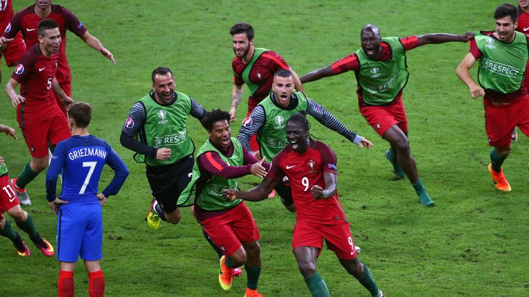 Eder (C) of Portugal is chased by jubilant team-mates after his extra-time strike against France in the Euro 2016 final