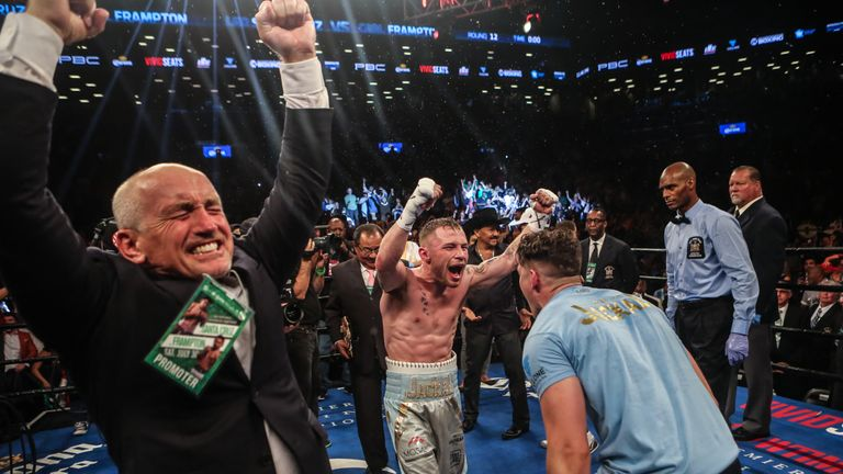 Carl Frampton (C) celebrates winning the WBA featherwight title with trainer Shane McGuigan (R) and manager Barry McGuigan (L)