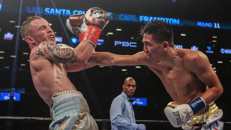 NEW YORK, NY - JULY 30:  Leo Santa Cruz of Mexico (gold trunks) fights Carl Frampton of Northern Ireland (blue trunks) during their  12 round WBA Super  fe
