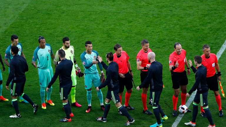 Cristiano Ronaldo and Gareth Bale shake hands before the match in Lyon