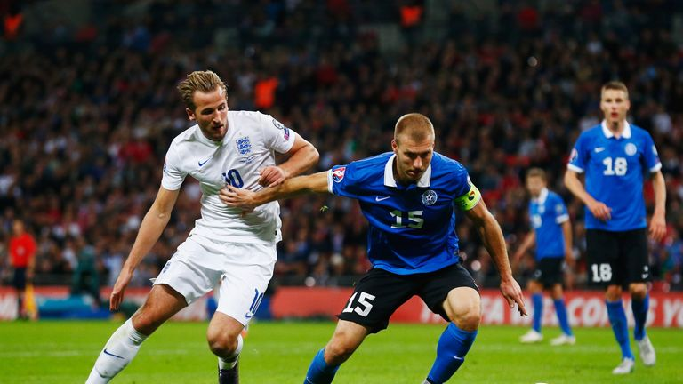 Klavan holds off Harry Kane during a Euro 2016 qualifier at Wembley