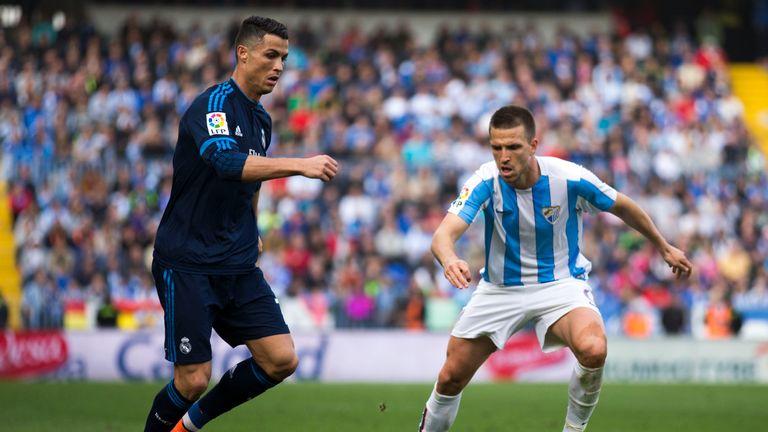 MALAGA, SPAIN - FEBRUARY 21: Cristiano Ronaldo (L) of Real Madrid CF Ignacio Camacho (R) of Malaga CF during the La Liga match between Malaga CF and Real M