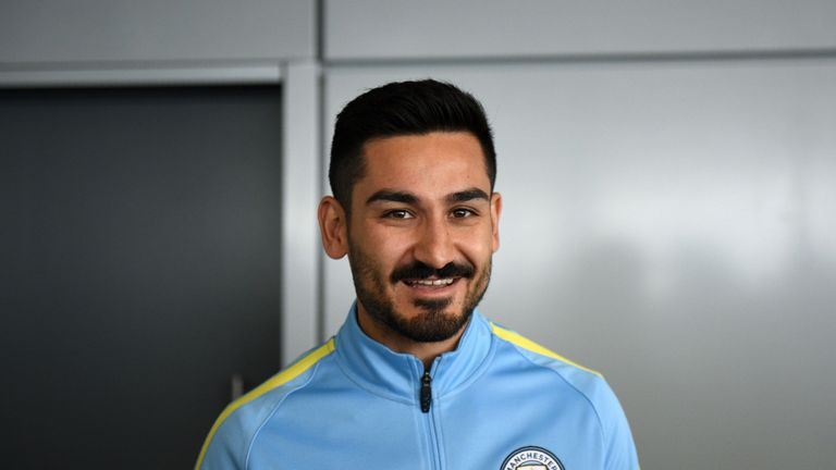 Manchester City's German midfielder Ilkay Gundogan arrives to meet members of the media at the City Football Academy in Manchester, north west England on J
