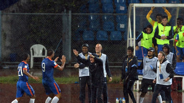 India's forward Robin Singh  (2L) celebrates with coach Stephen Constantine (C) during the the Asia Group D FIFA World Cup 2018 qualifier against Guam