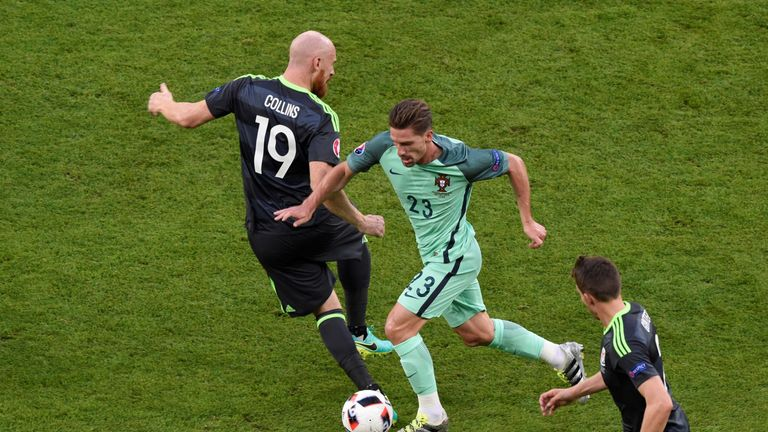Wales' defender James Collins, Portugal's midfielder Adrien Silva and Wales' defender Chris Gunter vie for the ball